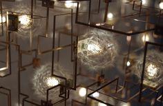 """Kronleuchter """"Concrete Chandelier"""" von #StudioDrift. Serie """"Fragile Future II"""", 2010. Löwenzahnsamen, Bronze, LEDs, Beton, 49,5 x 73,25 x 73,5 cm"""