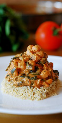 Gluten-free food: Chickpea and vegetable curry with quinoa. Curry flavors, chickpea, spinach, mushrooms in a curry broth over quinoa.
