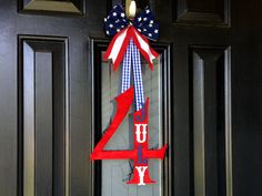 Making a Snowflake Monogram Wreath has never been easier. Give a Snowflake Monogram Wreath as a gift or make at home with the kids. Fourth Of July Decor, 4th Of July Decorations, 4th Of July Party, July 4th, 4th Of July Wreath, Patriotic Wreath, Patriotic Crafts, Outdoor Decorations, Americana Crafts