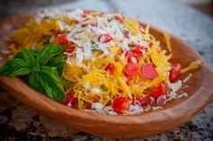 Spaghetti Squash with Tomatoes and Basil - spaghetti squash, olive oil, garlic cloves, chopped tomatoes, fresh basil, salt & pepper of choice, balsamic vinegar, grated Parmesan cheese