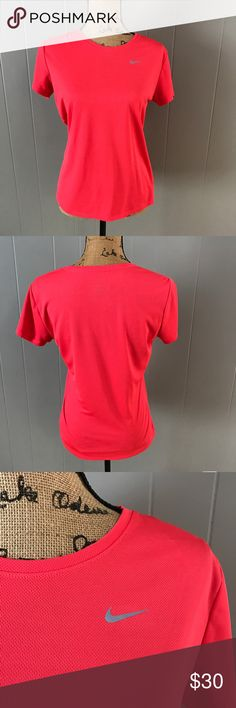 Nike Dry Fit Workout Top Excellent condition! Worn 2-3 times. Red Nike Dry Fit top, size medium. 100% polyester. Reasonable offers accepted thru the offer button! Nike Tops Tees - Short Sleeve