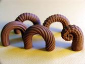 Handles using textured boards and twisting or rolling first in one direction and then another...