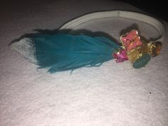 Feather headband  (All bows and headbands are custom made and inspired by my daughters)