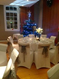 White chair covers with Silver organza sashes
