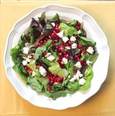 Bright tasting and colorful mixed produce salad with greens, pomegranate kernels and crumbled feta.  Vinaigrette has pomegranate jelly or syrup with red wine vinegar and Dijon mustard.  Drizzle this salad with a ruby glistening dressing.