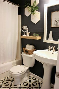 Bathroom Decor Small Bathroom Remodel Reveal This small guest bathroom got a big update on a tight budget. With dark moody walls, loads of texture, and eclectic modern accents, this remodel is a must-see. Bathroom Trends, Bathroom Renovations, Bathroom Designs, Budget Bathroom Remodel, Bathroom Ideas On A Budget Small, Bathroom Makeovers On A Budget, Decorating Bathrooms, Restroom Remodel, Condo Remodel