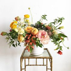 Summery centerpiece with an eclectic mix of fruits and flowers