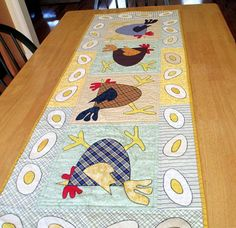 A perfect addition to a Country Kitchen! This table runner is made from a pattern by Mad Creek Designs called Scrambled Eggs. It is 50 1/2 long by 19 wide. I used a lot of different fabrics so it has a scrappy country look. I love how it turned out! Each applique piece is machine
