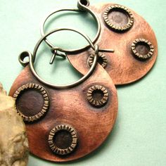 Earrings | Dante and Sabrina Acevedo ~ Sun Tribe Designs. Copper and sterling silver.