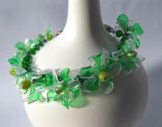 ReJenisis, Upcycled plastic bottle flower bracelet.