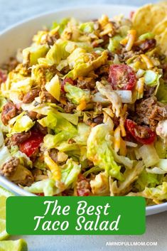 Taco Salad is a family favorite! This recipe for Taco Salad is easy, healthy, and can be adapted for any dietary needs! Made with taco meat, chopped lettuce, and a creamy salsa dressing. #tacos #tacosalad #easymeal #glutenfree