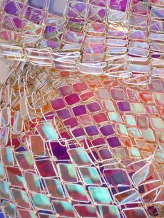 """""""Capturing Resonance"""" is made of thousands of pieces of colored acrylic inserted in chain link fencing"""