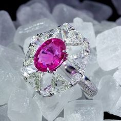 A pink sapphire and diamond ring by Forms.