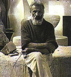 Constantin Brancusi - Romanian Sculptor    Period photograph showing the artist in his Paris studio in Impasse Ronsin, Montparnasse