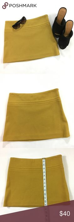 Mustard Theory Mini Skirt Great worn quality. No obvious flaws or holes. Size 0 mustard wool blend mini skirt by theory. Theory Skirts Mini