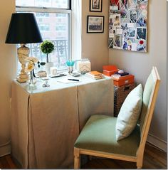 Habitually Chic - Ballard chair  Love the way the table skirt is folded- looks good, hides storage & is done in what I would call a type of linen