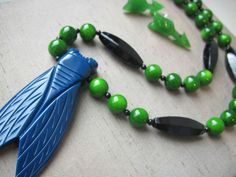 Cicada necklace in blue and green by Hotcakes Design