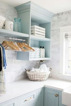Organized blue and white laundry room