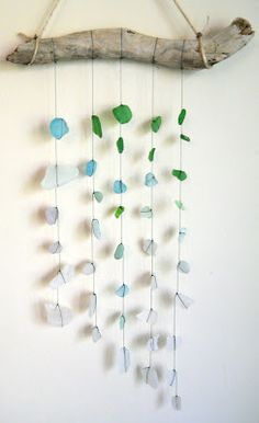 Sea Glass hanging from driftwood- would make a gorgeous backdrop behind the altar
