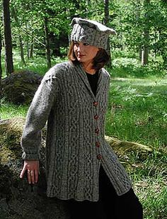"Jacket and matching hat incorporating lovely S-hitch panels set off by plain stockinette. Shaped shawl collar and ""swagger silhouette"" is flattering on most figures. Challenging garment with charted stitch patterns. Published in Book Nine: The Second Viking Knits Collection"
