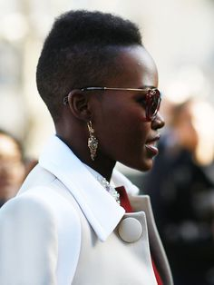 Lupita Nyong'o's accessories sparkled  - Paris Fashion Week #StreetStyle Fall 2014 #PFW