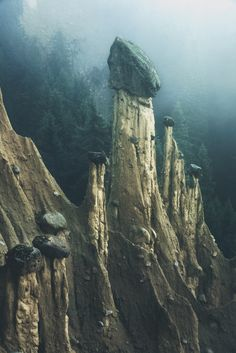 Otherworldly 'Earth Pyramids' Captured in the Foggy Early Morning Light by Photographer Kilian Schönberger | Colossal
