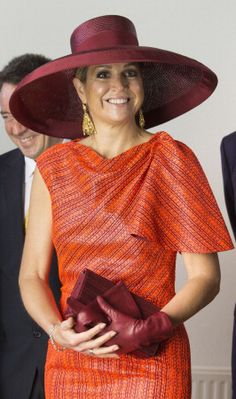 Queen Máxima of the Netherlands in an orange strié snakeskin dress crowned by a large burgundy picture hat with a wide brim and burgundy clutch. A stunning combination that works on the wife of the House of Orange! ~ At the Dutch Freedom Awards, May 24, 2014 ~ Photos from Adam Nurkiewicz, Adam Nurkiewicz, Michel Porro and Michel Porro via Getty