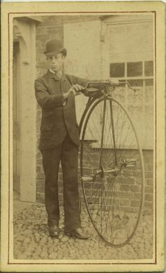 unknown man and penny farthing bike