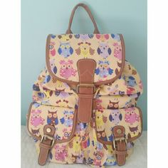 OWL PRINT ANY AGE BACKPACK WELL DESIGNED BACKPACK FOR ANY AGE. **** NEVER USED**** *LEATHER STRAPS *ADJUSTABLE STRAPS WITH METAL RUNNERS * TWO OUTSIDE POCKETS WITH CLIP ON     METAL BUTTONS * ONE INSIDE ZIPPER POCKET AND TWO     SMALL SLIP ON POCKETS FOR EASY ACCESS  * INSIDE NICE GOLD, SILK LINING ( SEE PICTURES FOR MORE DETAILS) Bags Backpacks