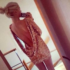 gold glitter sequenced dress with a low open back