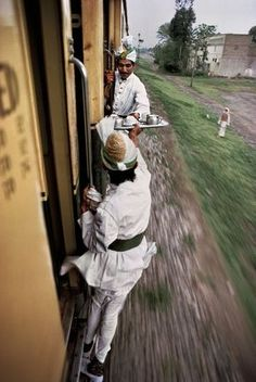 PAKISTAN—Breakfast tea being passed between cars on the railway between Peshawar and Lahore, © Steve McCurry / Magnum Photos In This World, We Are The World, People Around The World, Around The Worlds, Magnum Photos, Photos Du, Cool Photos, Amazing Pictures, Share Photos