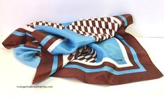 Extra long silky scarf with op-art design at #VintageVenturesShop #Etsy to buy click image #VintageScarf #Vintage #VintageScarf #VintageFashion #Retro #GermainScarf #OblongScarf #OpArt #MidCenturyFashion #RetroFashion #BlueScarf #BrownScarf #FiftiesFashion #Retro