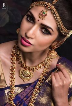 South Indian bride. Gold Indian bridal jewelry.Temple jewelry. Jhumkis. Purple silk kanchipuram sari.braid with fresh jasmine flowers. Tamil bride. Telugu bride. Kannada bride. Hindu bride. Malayalee bride.Kerala bride.South Indian wedding.