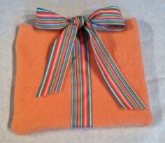 Orange sherbet colored iPad cover with striped ribbon. $20.00, via Etsy.