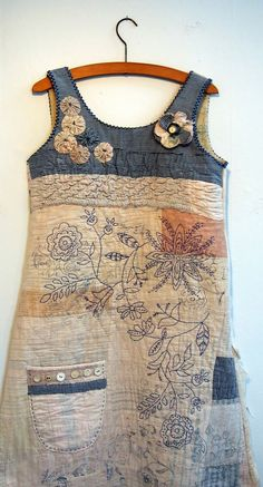 """Mandy Patullo: """"Another recycled vintage quilt. This one has been made up into a dress using a 1980s Clothkits dress pattern. I have over printed and embroidered it and embellished the bodice with my trademark suffolk puffs."""":"""