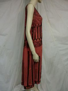 1920's Art Deco Beaded Swallowtail Motif Flapper Dress | From a collection of rare vintage evening dresses at http://www.1stdibs.com/fashion/clothing/evening-dresses/