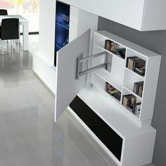 Salón Comedor con Mueble TV Blanco. Detalle Ambiente 1912 - Colección ONA - Baixmoduls. Paneles TV blanco con estanteria . Giratorio, para televisiones de gran tamaño.:
