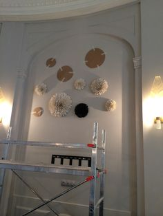 The installation of black and white porcelain flowers with gold leaf