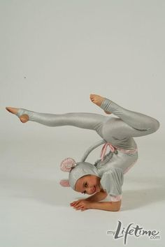 """Mackenzie doing an elbow stand in her """"Mouse Trap"""" costume."""