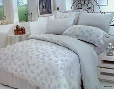 This magnificent duvet bedding set has a light-silver-blue backdrop with Alice-blue weaving of abstract feather patterns that creates the most elegant setting for your bedroom. This 100 % Organic Bamboo fabric combine all the benefits of satin, silk, and high quality Egyptian cotton bed sheets. The 400 Thread Bamboo Organic Fiber is softer than the finest cotton, has a natural shine and a feel of touch similar to silk or cashmere.  It lets your body breath, and balances the body temperature.