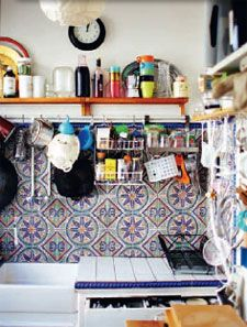 "vintage patterned tile backsplash + solid color tile counters + accent color tile edging (Rachel Khoo's ""My Little Paris Kitchen"")"