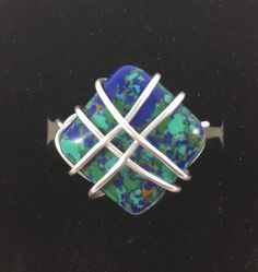 A personal favorite from my Etsy shop https://www.etsy.com/listing/516871442/blue-braided-ring-wire-wrap-ring