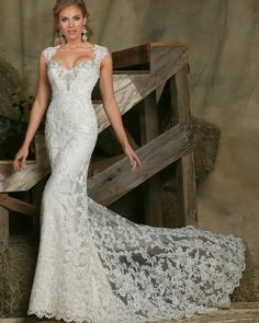 We can't get enough  of the beautiful lace on this #DaVinciBridal gown!