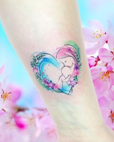 awesome watercolor tattoo for mothers © tattoo artist Adrian Bascur