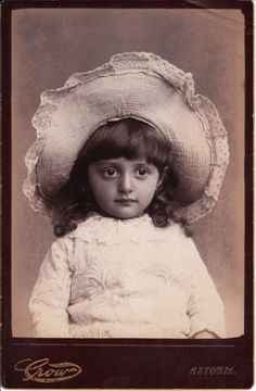 cabinet card. Darling child in a big hat.