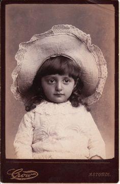 cabinet card. Darling child in a big hat.