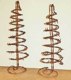 My own idea and they've been a pretty good seller!  Spiral barbed wire trees.