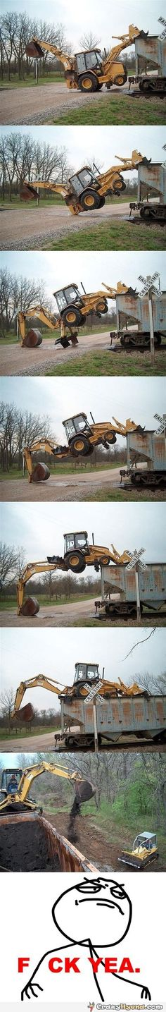 Funny excavator climbs on a wagon