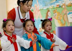 The triplets - North Korea by Eric Lafforgue, via Flickr