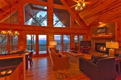 Appalachian Sunrise  | Cabin Rentals of Georgia - Spacious Living Area with Stunning Window Wall and Cozy Stone Gas Log Fireplace